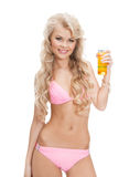 Woman in bikini with cocktail. Woman in bikini with glass of juice or cocktail Royalty Free Stock Photo