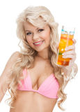 Woman in bikini with cocktail. Woman in bikini with glass of juice or cocktail Royalty Free Stock Image