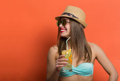 Woman in bikini with a cold drink Royalty Free Stock Photos