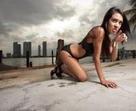 Woman in a bikini crawling Stock Photography