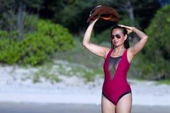 Woman and bikini crimson show sexy on beach. At  Ban Krut Beach, in Prachap Kirikhun Province Thailand is famous for travel stock photo