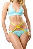 Woman in bikini in diet concept Stock Photography