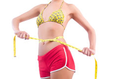Woman in bikini in diet concept Stock Image