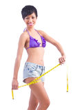 Woman in bikini in diet concept Royalty Free Stock Images