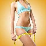 Woman in bikini in diet concept isolated on white Stock Photography