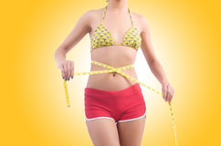 Woman in bikini in diet concept  Royalty Free Stock Image