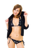 Woman in bikini dressing jacket. Young beautiful woman standing in bikini dressing jacket, smiling, looking at camera, fullface view Royalty Free Stock Images