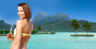 Woman in bikini with drink on bora bora beach Royalty Free Stock Photos