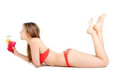 Woman in bikini drinking a cocktail Stock Photos