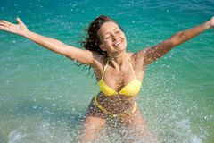 Woman in bikini enjoing in sea Stock Photography