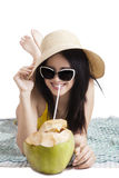 Woman with bikini enjoy coconut water Royalty Free Stock Photos