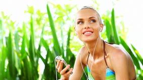 Woman in bikini enjoying her music stock video footage