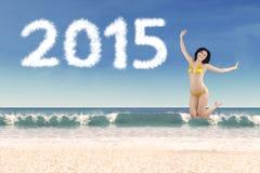 Woman in bikini enjoying new year holiday Stock Images