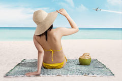 Woman in bikini enjoying summertime Stock Photography