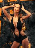 Woman in bikini and fire background Royalty Free Stock Photo