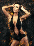 Woman in bikini and fire background Stock Photos
