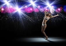 Woman in bikini and hat dancing Stock Photos