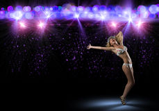 Woman in bikini and hat dancing Royalty Free Stock Photos
