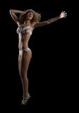 Woman in bikini and hat dancing Royalty Free Stock Photos