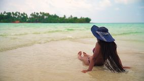 Young beautiful asian girl in bikini enjoy summer holidays on tropical beach. Summer vacation and LifeStyle concept. Woman in bikini and hat enjoy summer stock video