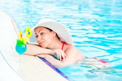 Woman in bikini and hat in the pool Royalty Free Stock Photo