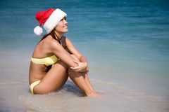 Woman in  bikini and hat of Santa Claus Stock Photo