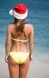 Woman in  bikini and hat of Santa Claus Royalty Free Stock Photography