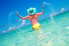 Woman in bikini having fun on the beach in Exuma, Bahamas Royalty Free Stock Photos
