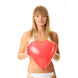 Woman in bikini with heart shaped baloon Royalty Free Stock Images