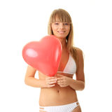 Woman in bikini with heart shaped baloon Stock Photo