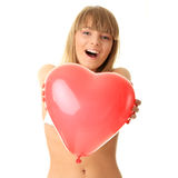 Woman in bikini with heart shaped baloon Stock Photos