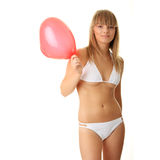 Woman in bikini with heart shaped baloon Royalty Free Stock Photo