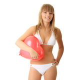 Woman in bikini with heart shaped baloon. Happy young woman in bikini with heart shaped balloon - valentines concept Stock Image