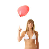 Woman in bikini with heart shaped baloon. Happy young woman in bikini with heart shaped balloon - valentines concept Stock Photo