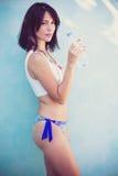 Woman in bikini hold bottle of water stock photography