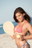 Woman in bikini holding a beach racket Stock Photo