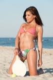 Woman in bikini holding a beach racket Stock Image