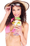 Woman in bikini holding cup of fruits Stock Photography