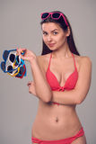Woman in bikini holding many colourful sunglasses Stock Photos