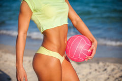 Woman in bikini holding a volleyball Royalty Free Stock Image