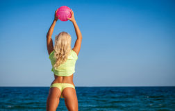 Woman in bikini holding a volleyball Royalty Free Stock Photo