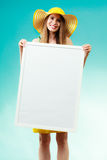 Woman in bikini holds blank presentation board. Royalty Free Stock Images