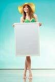 Woman in bikini holds blank presentation board. Stock Images