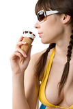 Woman in bikini with ice cream cone in summer Stock Photos