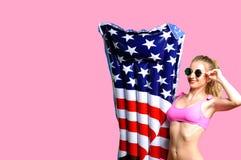 Woman in bikini with inflatable mattress ice cream on the beach. Stock Photography