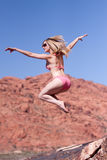 Woman in bikini jumping outdoors Stock Photography