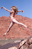 Woman in bikini jumping outdoors Royalty Free Stock Images