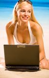 Woman in bikini with laptop Royalty Free Stock Photography