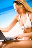 Woman in bikini with laptop Royalty Free Stock Image