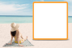 Woman with bikini and look at signboard Royalty Free Stock Images